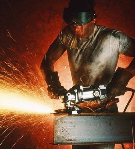Man with a Grinder on a Steel Beam