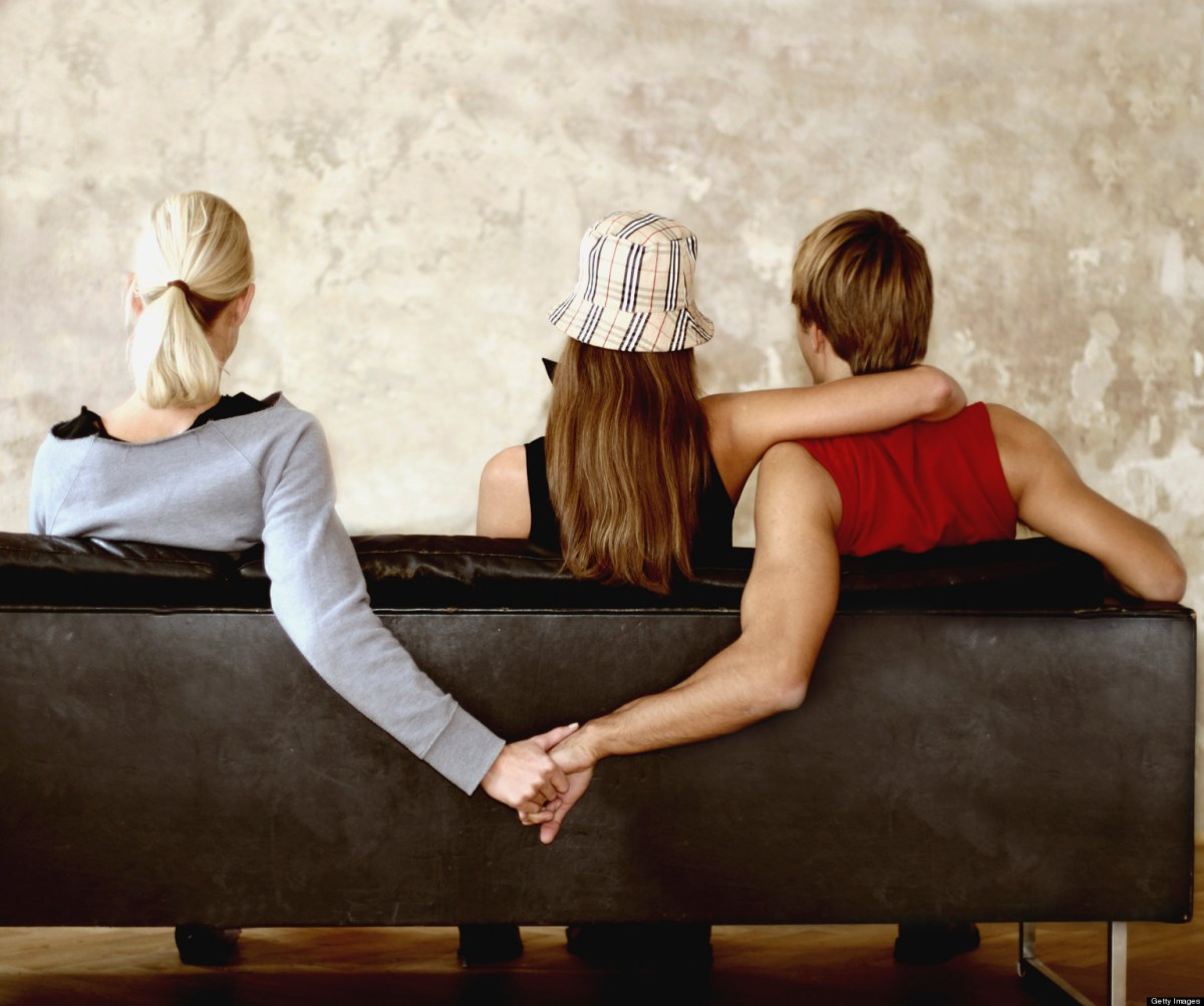 People Holding Hands on Sofa