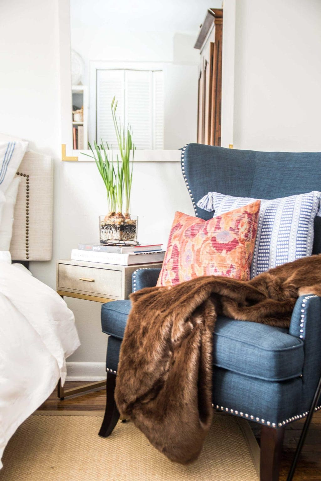 chair for bedroom ergonomic drafting canada why your needs an accent thou swell i filled the with a brown faux fur throw seriously best ve ever felt and cozy ikat pillow to add perfect pop of red