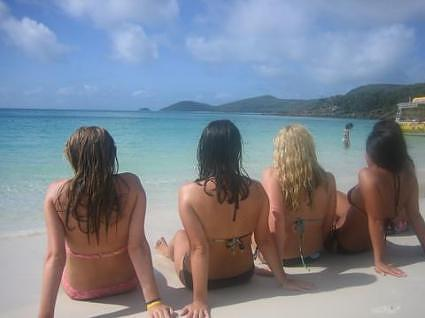 the girls on whitehaven beach in the whitsundays