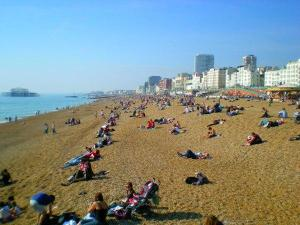 Sunning at Brighton Beach, East Sussex, England