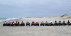 Riding 4 wheelers - ATVs on dunes at Carilo