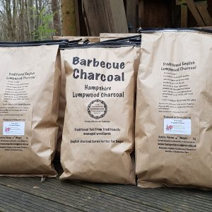 three hampshire coppice craftsmens group branded charcoal bags loaded and ready to go