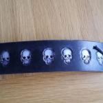 black leather cuff with white scull design