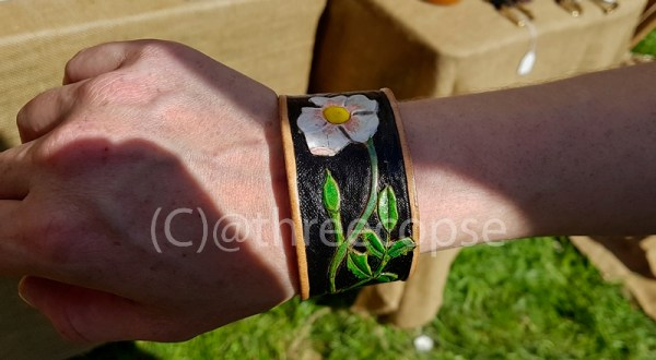 leather hand carved cuff with rose design painted in acrylic