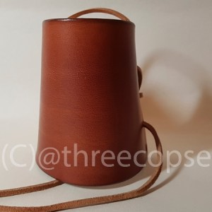 a leather arm guards in brown with leather laces