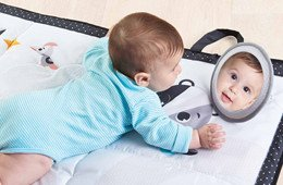 The mat's activities encourage baby to stay in tummy time