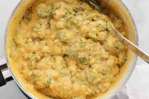 Vegan nacho cheese sauce with roasted broccoli and chickpeas.