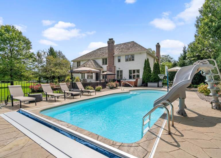 Photo of the pool in the backyard of the house for sale, captured by a professional real estate photographer