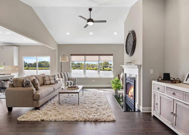 Professional photo of a real estate listing for sale, beautiful living room with large windows, a fireplace nice views
