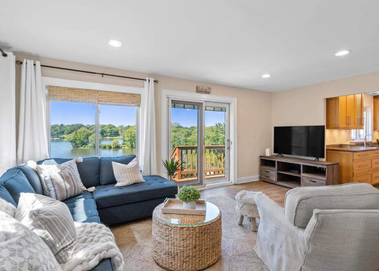 Photo of an AirBnb listing, beautifully staged living room with a lake views