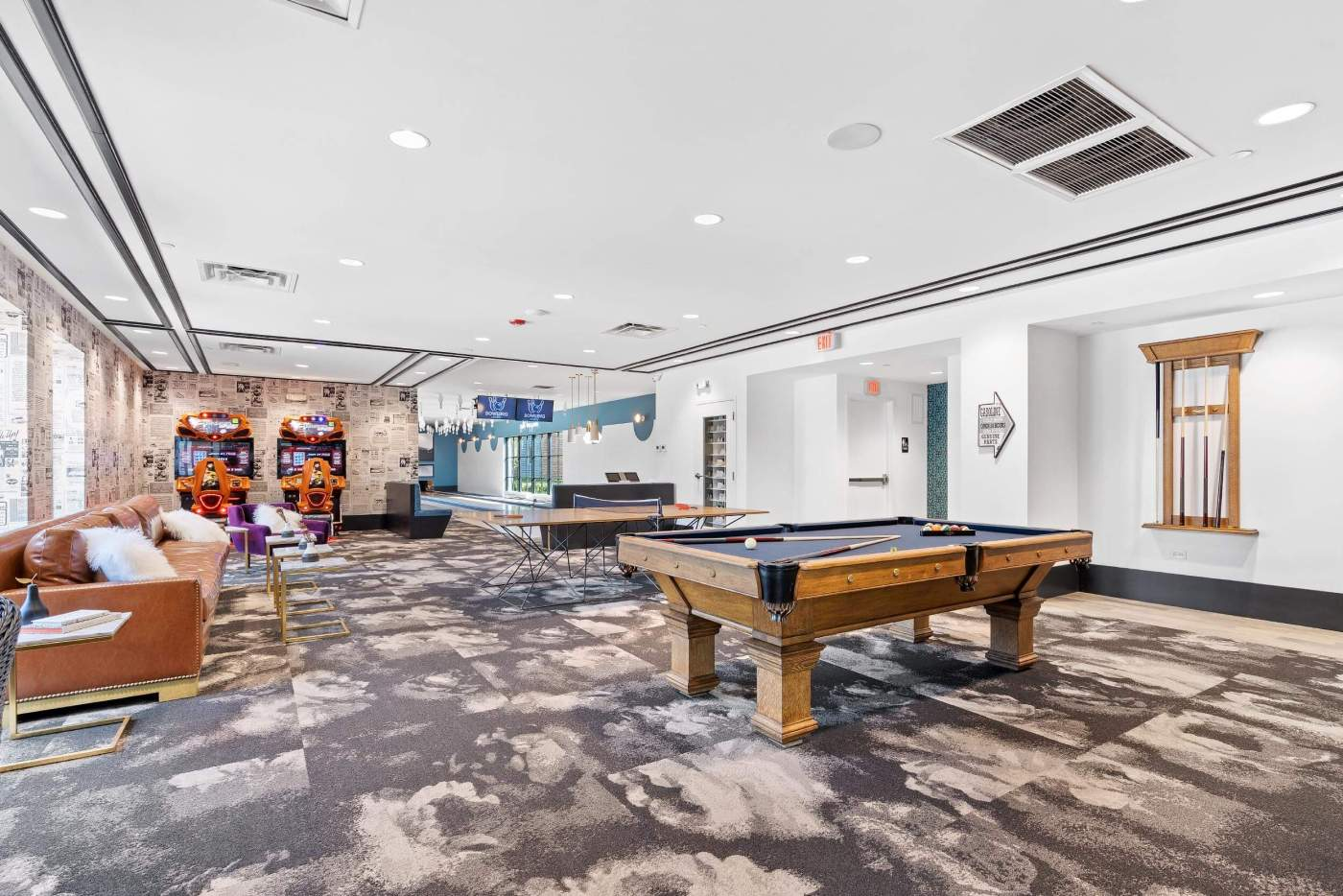 Commercial real estate photo of the entertaining area with pool table and bowling lanes