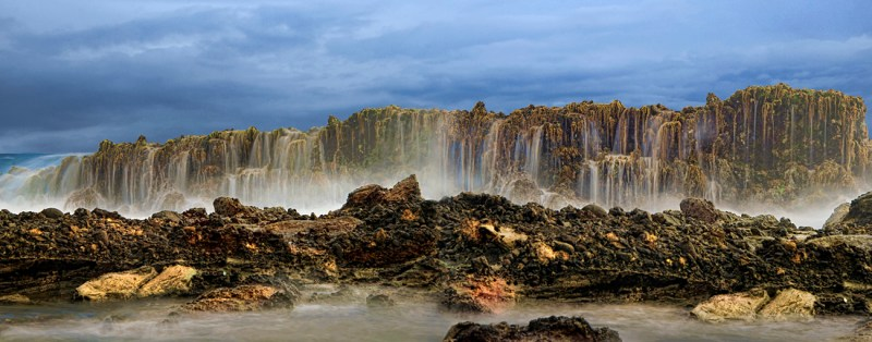 Waterfall at Sawarna beach, photo credits to flickr@alex hanoko
