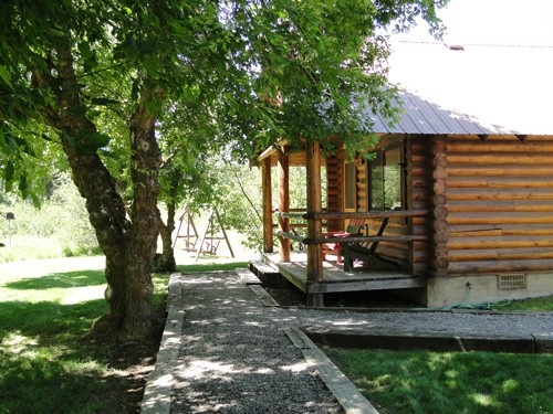 Each cabin lies under a canopy of cottonwood trees.