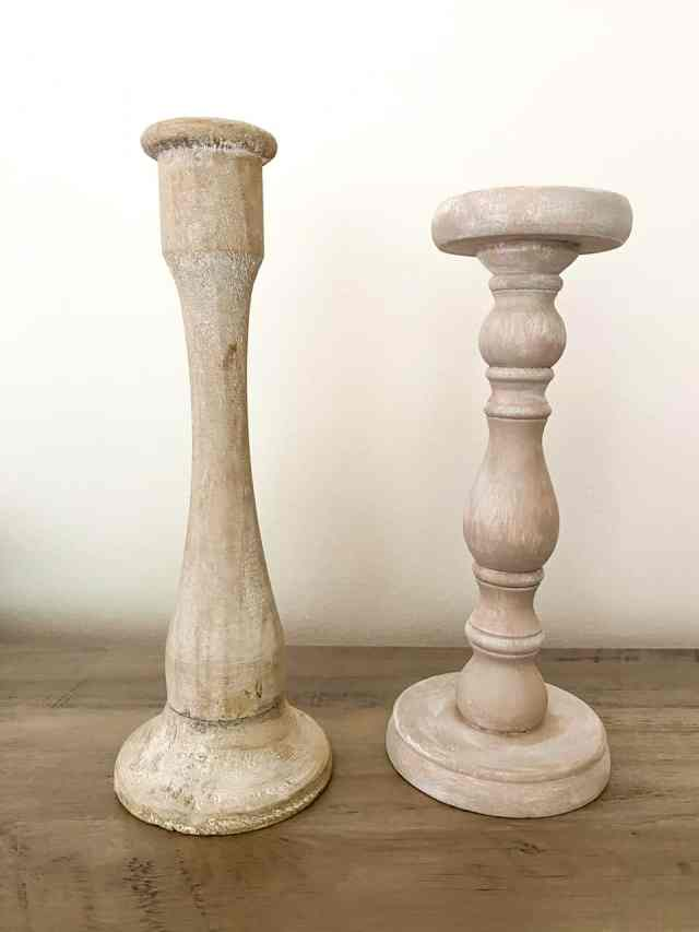 The candle holder on the left is what I used an inspiration to make the candle holder on the right. Check out how I turned these dark stained candle holders into some modern farmhouse style, faux bleached wood upcycled candle holders only using paint!