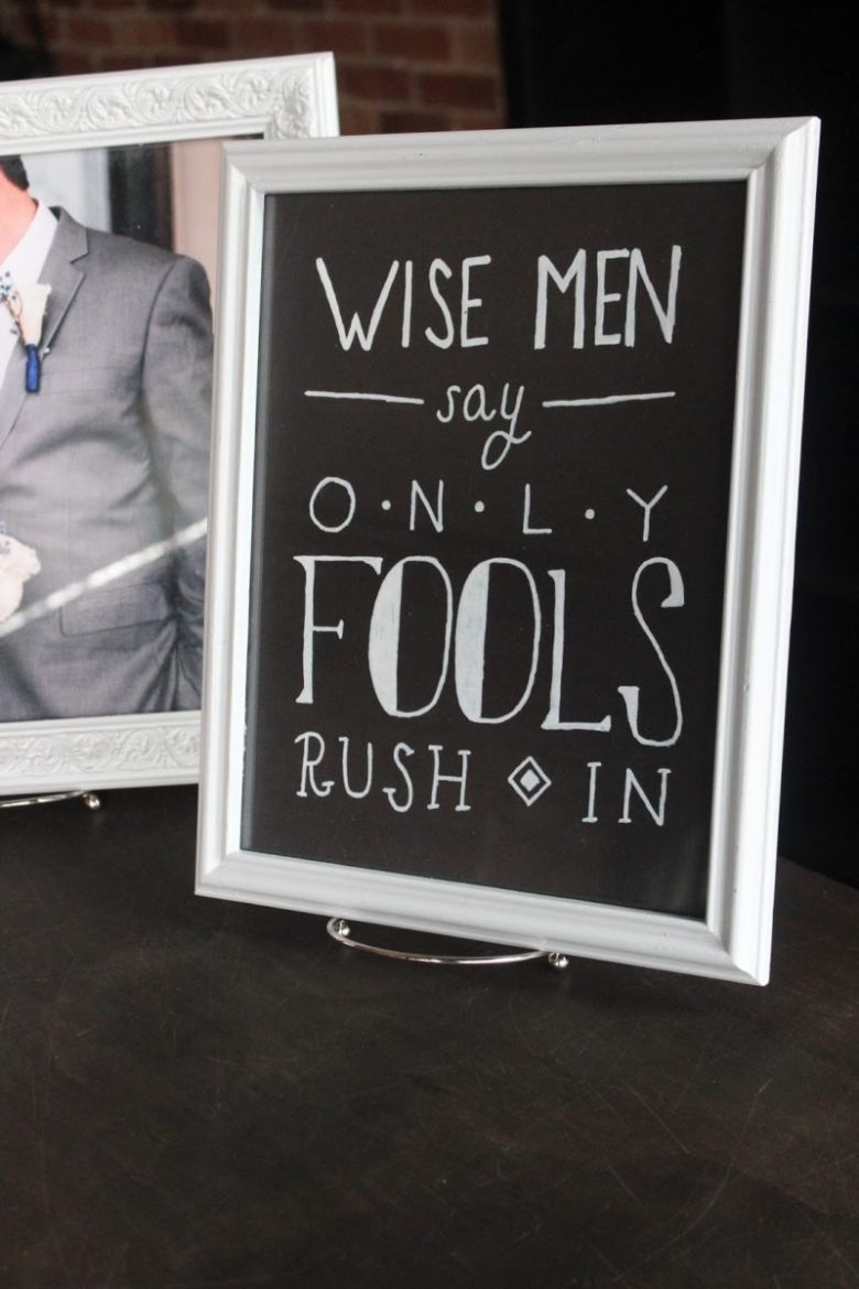 Wise men say only fools rush in wedding decor
