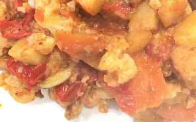 Kounoupithi Yiahni or Tomato Stewed Cauliflower. A traditional Greek food