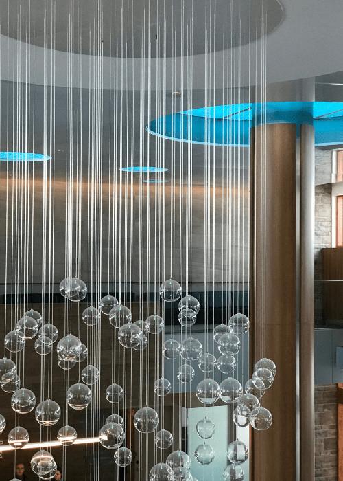 valcartier_lobby_blue_light_suspended_bulbs