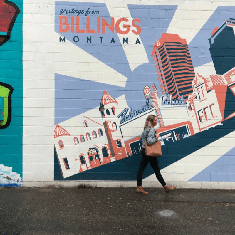 girl_walking_in_front_of_mural_downtown_billings_montana