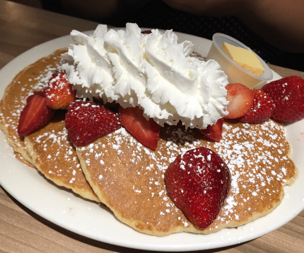 pancakes_loaded_with_strawberries_andwhipped_cream_jines_restaurant_rochester_new_york