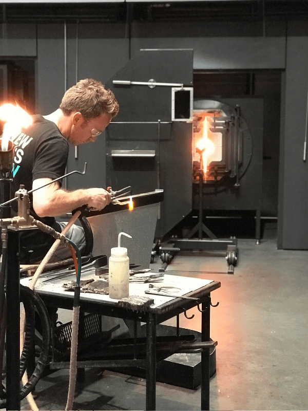 things to do in corning new york worker making glass