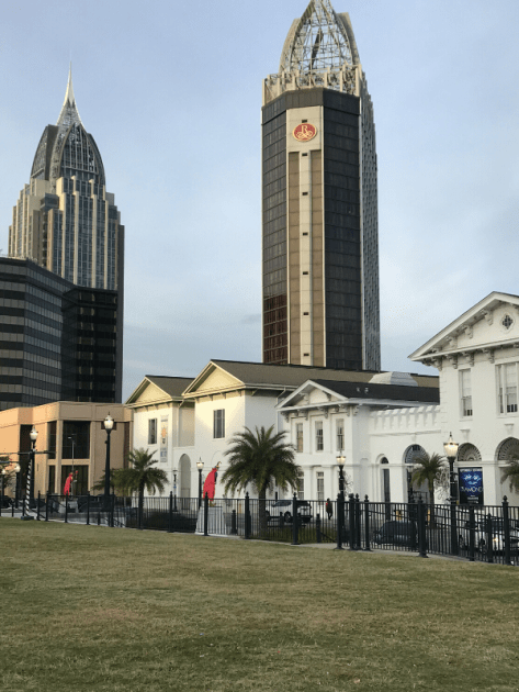 Mobile History Museum in foreground with Renaissance Riverview tall building in centre