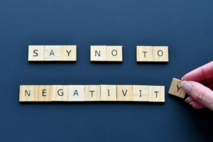 Say No To Negativity - wooden tiles spelling out a message promoting positive thoughts