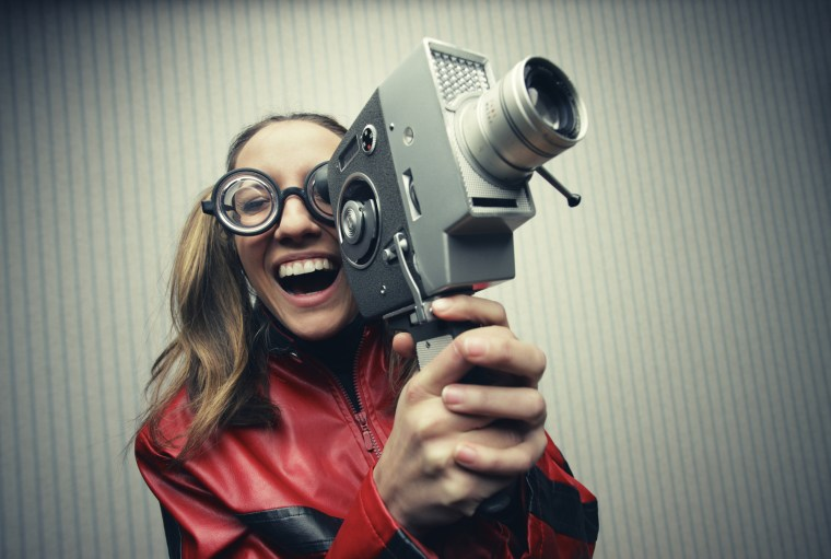 Nerdy woman with old fashion video camera