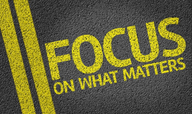 Focus on what matters written on black road