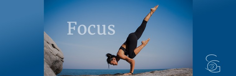 woman demonstrating focus in yoga pose