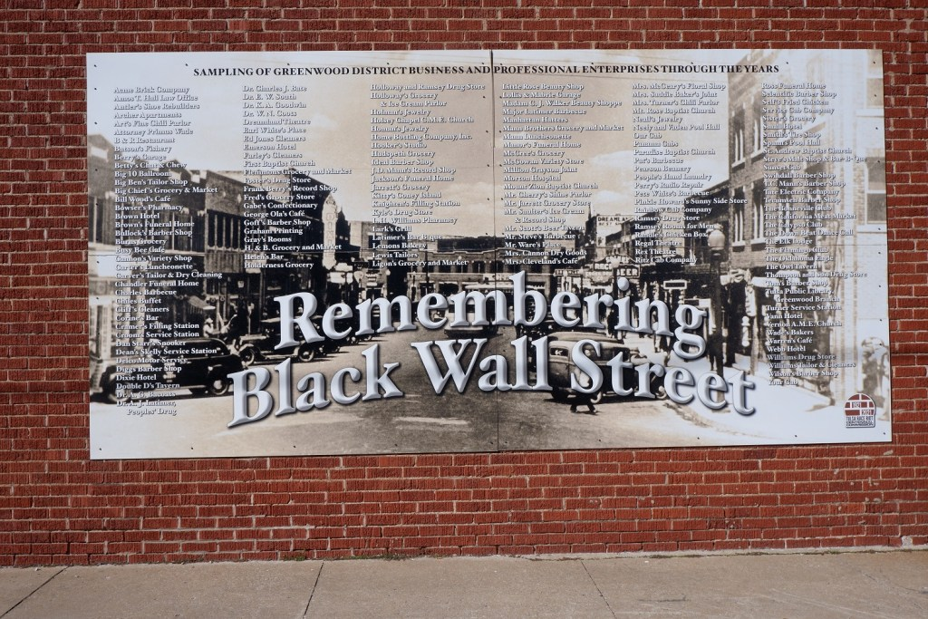 Mural in Tulsa with the sampling of Greenwood District business and professional enterprises through the years.