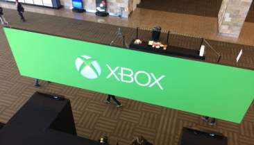 You may see an Xbox sign. Attendees see the set-up of a coffee station.