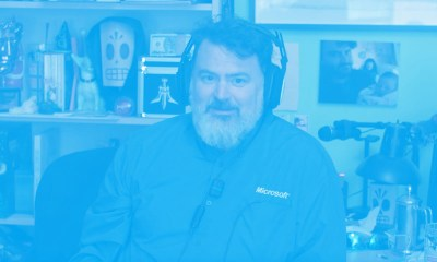Tim Schafer Microsoft shirt listening to actual Zune