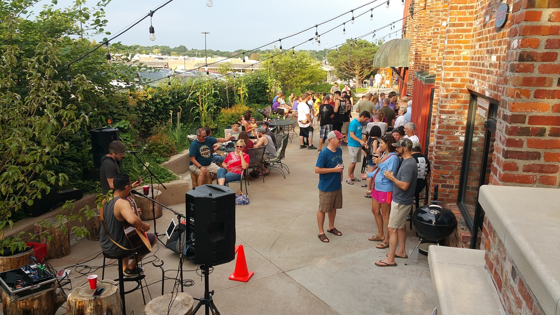 People in Outside Event Space Enjoying Musical Entertainment