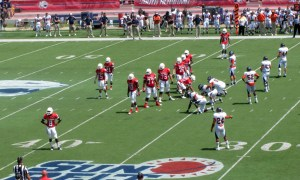 The Jaguar offense looks to the sideline for play adjustments against UTSA.