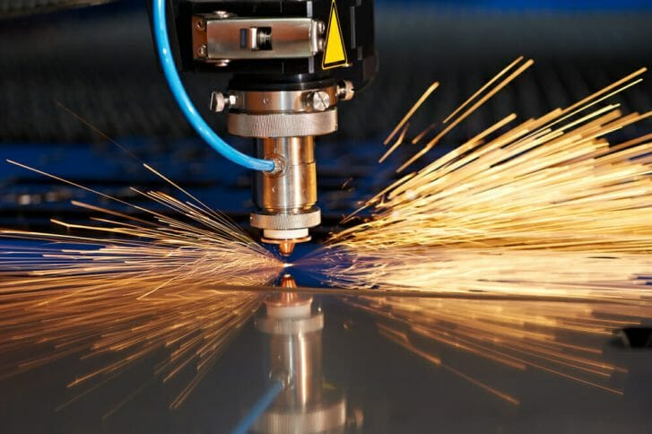Laser cutting of jewelry piece with sparks