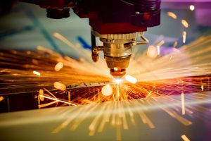 Industrial laser machine cutting away at metal