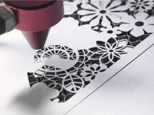 close up view of laser cutting paper sample - history of laser cutting