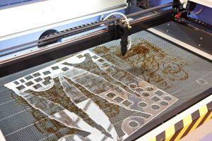 laser cutting acrylic machine close up process