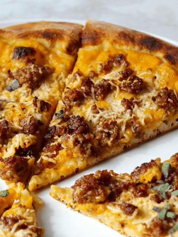 Pumpkin, Sausage, and Sage pizza, sliced
