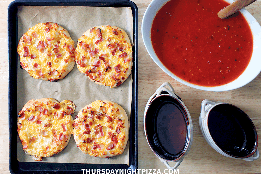 Personal pizzas and tomato soup, ready for serving