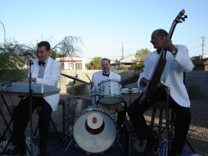 Sophisticate Howlies at the Morelli House Downtown If you want a classic Las Vegas lounge act vibe… the Thurston Howlies know how to dress it up in formal dashing dressy duds! We can do Black Tuxedos OR Classic Hollywood White Tux Jackets!