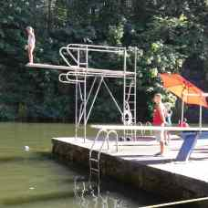 Chenel Mackley, 9, of Colorado musters the courage to take her very first jump off the high dive. Photo credit: Candice Holcombe