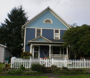 The McClelland House, as it looked in 2010, was built in the Pioneer style with Neo-Colonial details. This home was one of those developed by J.R. Chaplin on Olympia's West Side. Photo credit: Deborah Ross