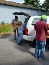 """With COVID restrictions, The Moore Wright Group also had to change how it operated. Where typically agencies can come in and """"shop"""", now donations are gathered and set outside to be picked up. A larger warehouse space would allow the group to continue to safety serve others directly. Photo courtesy: The Moore Wright Group"""