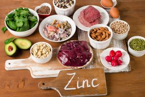 foods with zinc mineral on a wooden table. top view
