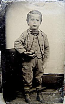 Tintype  Little boy holding apple or ball  C1860s