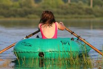 girl paddling an inflatable boat