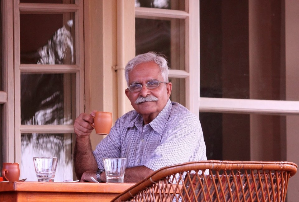 Dad enjoying his tea after an evening safari