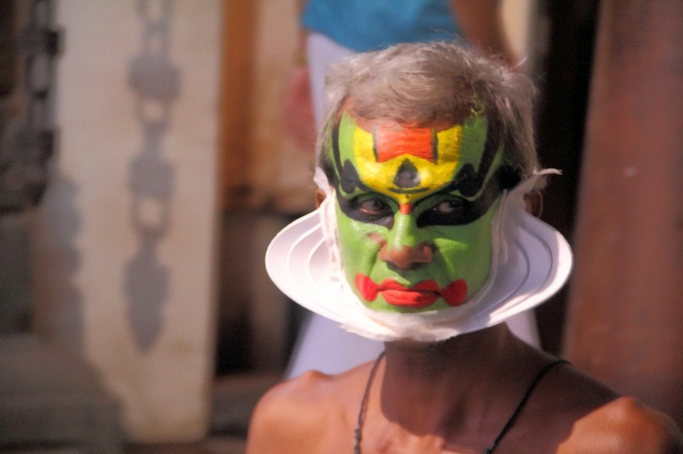 Kerala: Kathakali dancer with mask and make up
